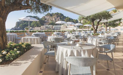 Mazzaro Sea Palace Sicily outdoor dining area tables chairs views  of the bay
