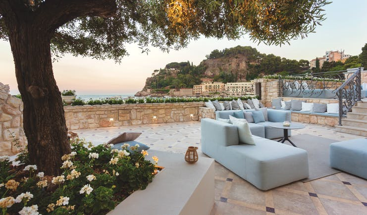 Mazzaro Sea Palace Sicily terrace outdoor seating area sofas armchairs
