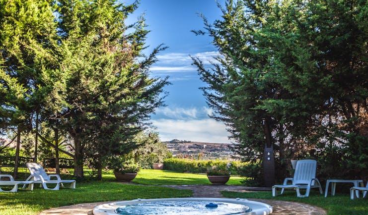 Hotel Baglio Della Luna Sicily outdoor jacuzzi lawns trees views of town
