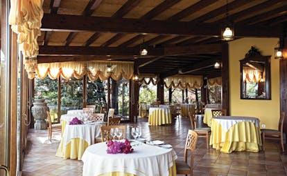 Hotel Baglio Della Luna Sicily restaurant indoor dining traditional décor