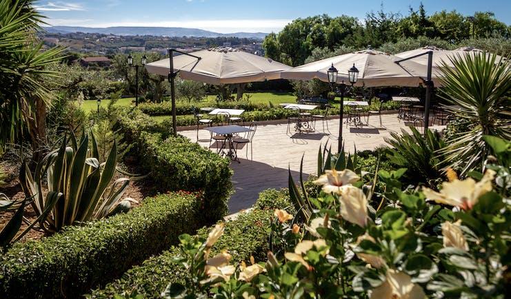 Hotel Baglio Della Luna Sicily terrace restaurant outdoor dining area overlooking the town