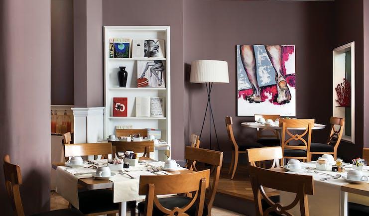 Hotel Principe di Villafranca breakfast room, tables and chairs, elegant modern decor
