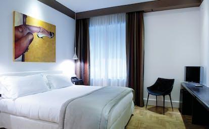 Hotel Principe di Villafranca deluxe room, double bed, bright modern decor