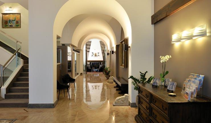 Hotel Principe di Villafranca hall, marble floors, archway, elegant decor