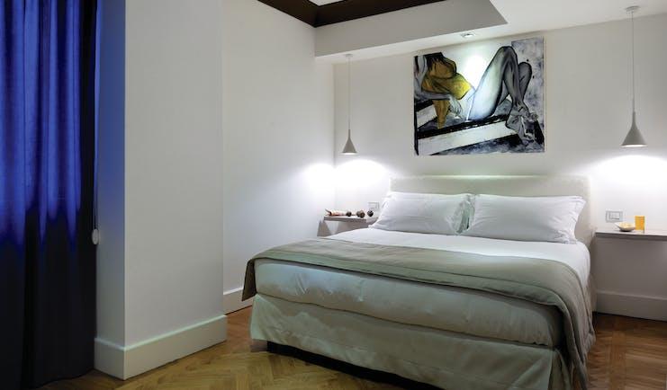 Hotel Principe di Villafranca superior room, double bed, white walls, wooden floors, modern decor