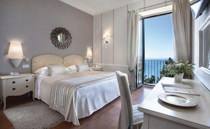 Hotel Villa Belvedere Sicily suite with balcony sea views contemporary décor