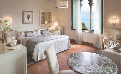 Hotel Villa Belvedere Sicily suite bed sofa contemporary seating area window with sea view