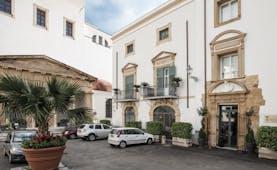 Palazzo Brunaccini Sicily hotel exterior white hotel building balconies