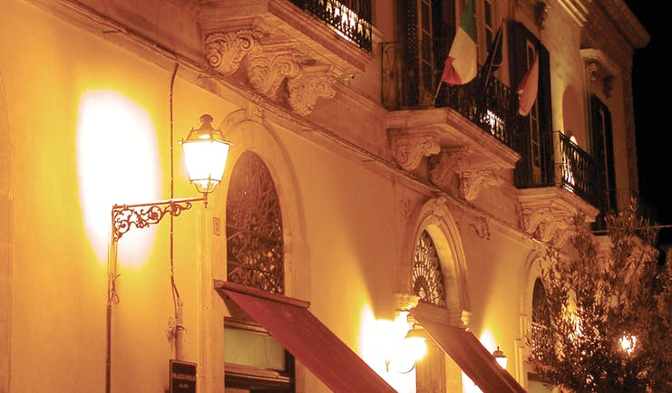 Palazzo Failla Sicily hotel exterior by night street lamp