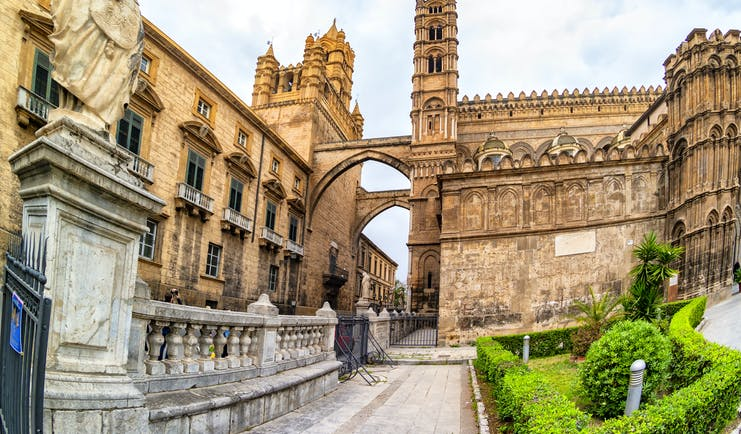 Intricate stonework of the Norman cathedral in Palermo with arches and towers