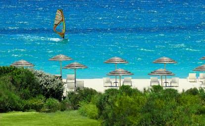 Verdura Resort view of beach with white sand and windsurfer