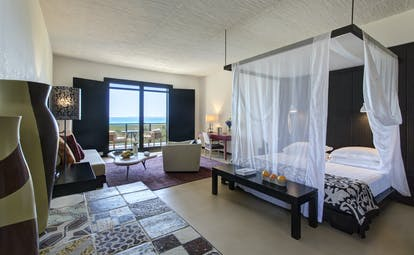 Verdura Resort four poster bed with sea view in distance
