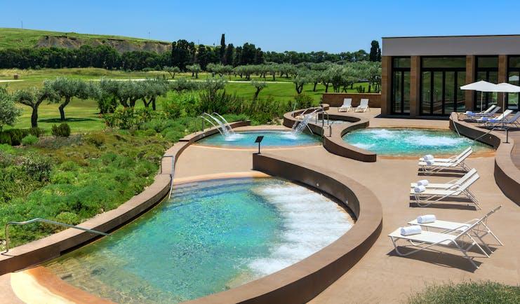 Verdura Resort curvy outdoor spa pools and terrace