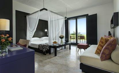 Verdura Resort superior deluxe four poster bedroom