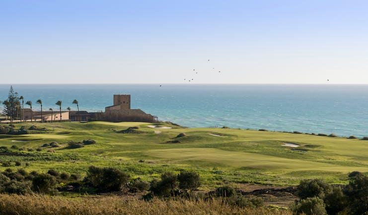 Verdura Resort golf course, sea and palm trees