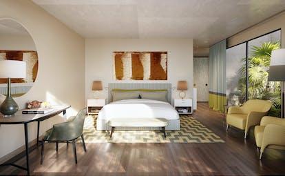 Verdura Resort bedroom with wooden floor and large windows in villa