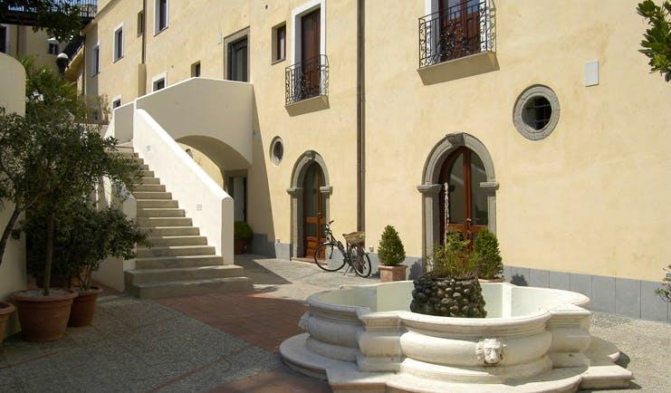 Villa Meligunis Sicily exterior hotel building patio water fountain