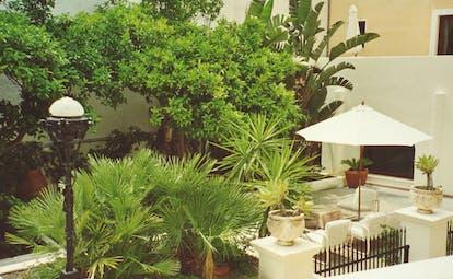 Villa Meligunis Sicily garden trees potted plants patio