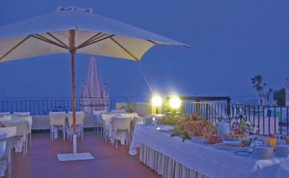 Villa Meligunis Sicily terrace restaurant by night