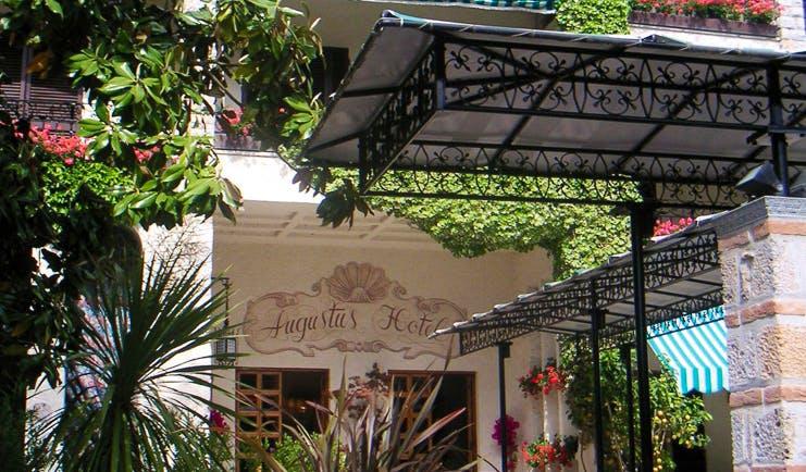 Augustus Hotel Tuscany entrance doorway trees shrubs