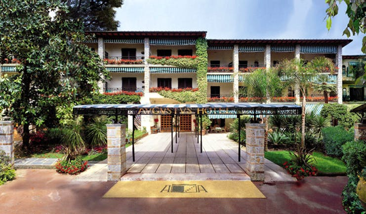 Augustus Hotel Tuscany exterior hotel entrance walkway hotel building lawns trees
