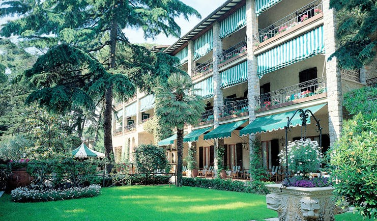 Augustus Hotel Tuscany grounds hotel building lawns trees potted plants