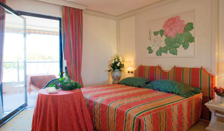 Cala del Porto Tuscany deluxe room bed access to private terrace elegant décor