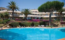Cala del Porto Tuscany exterior hotel building pool sun loungers umbrellas