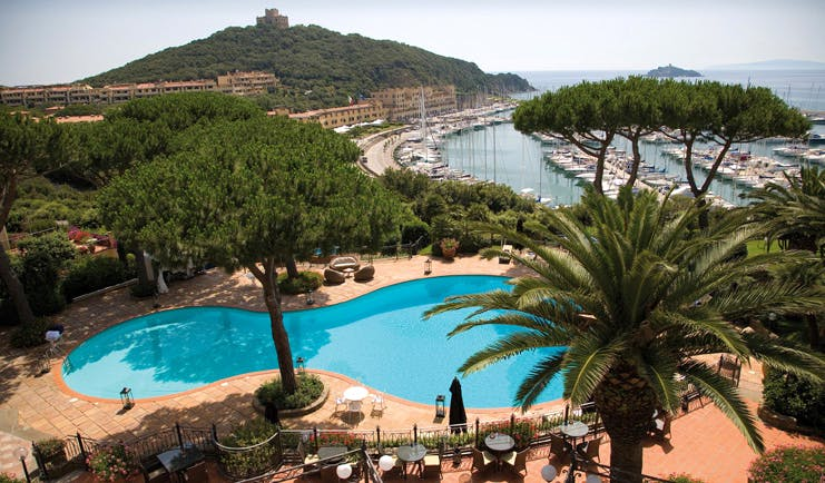 Cala del Porto Tuscany pool aerial shot terrace trees harbour in background