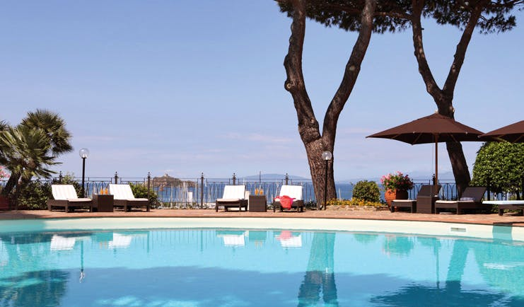 Cala del Porto Tuscany poolside pool terrace sun loungers umbrellas