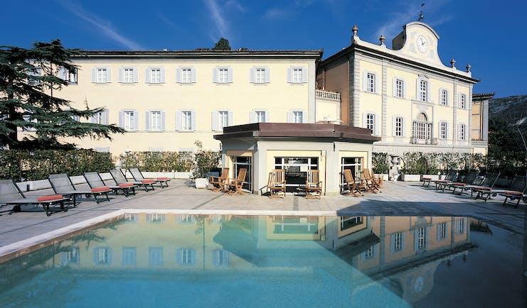 Bagni Di Pisa Tuscany hotel exterior pool terrace sun loungers hotel building