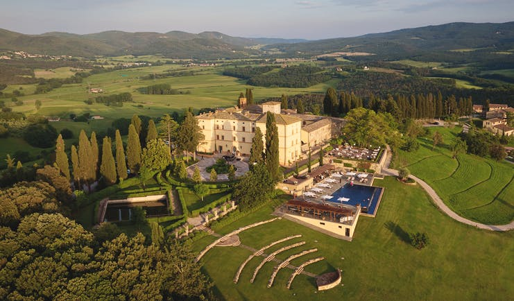 Belmond Castello di Casole Tuscany hotel exterior pool driveway rural surroundings