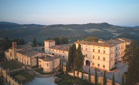 Belmond Castello di Casole Tuscany hotel exterior rural estate in background
