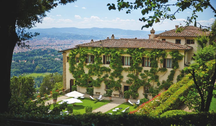 Villa San Michele Tuscany exterior hotel building lawns countryside in background