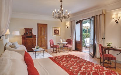 Villa San Michele Tuscany suite bed lounge area doors leading to terrace modern décor