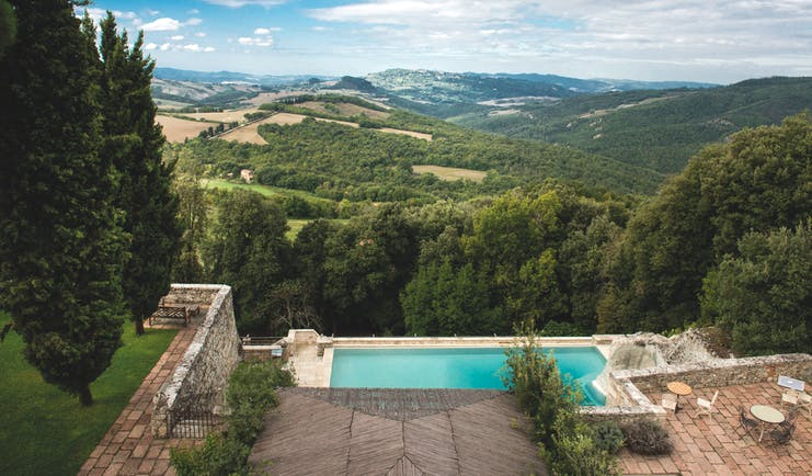 Borgo Pignano Tuscany pool terrace views of Tuscan countryside