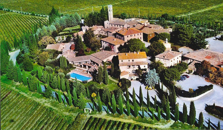 Hotel Borgo San Felice Tuscany aerial shot of resort hotel buildings lawns trees
