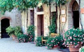 Hotel Borgo San Felice Tuscany courtyard bench flowers growing up wall