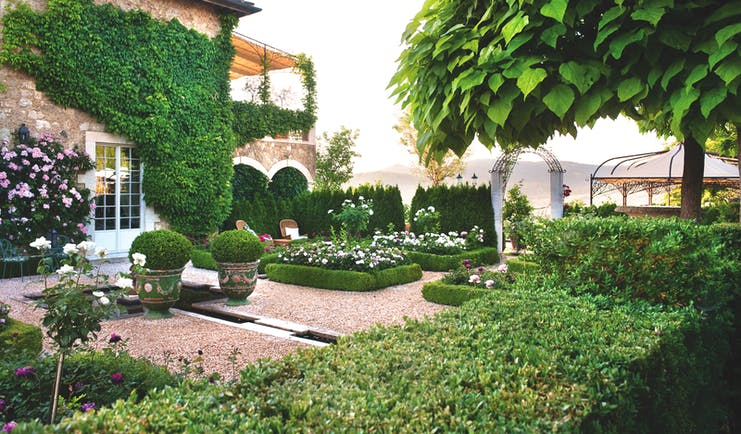 Borgo Santo Pietro Tuscany gardens greenery plants flowers