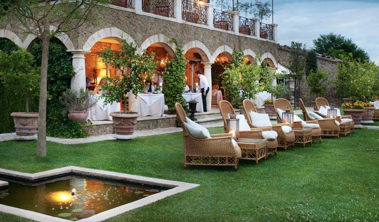 Borgo Santo Pietro Tuscany lawns outdoor seating area terrace restaurant