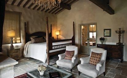 Borgo Santo Pietro Tuscany maggiorana suite four poster bed rustic décor
