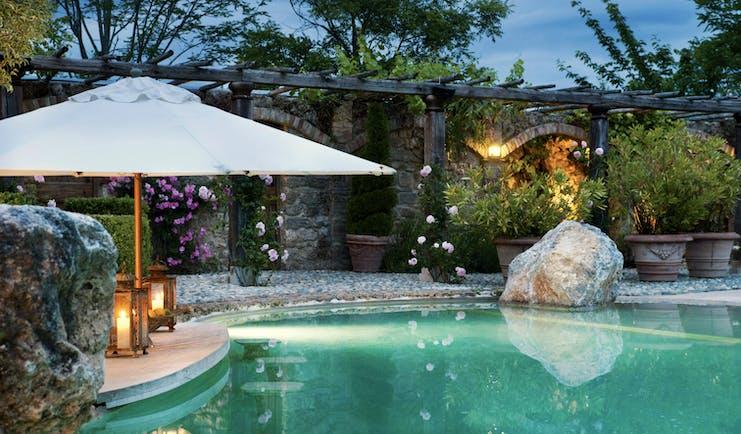 Borgo Santo Pietro Tuscany pool  terrace flowers umbrella