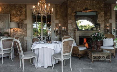 Borgo Santo Pietro Tuscany restaurant dining area fireplace