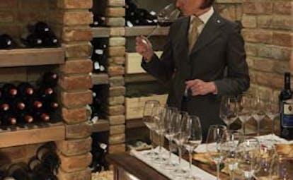 Borgo Santo Pietro Tuscany wine tasting wine cellar couple tasting wine waiter