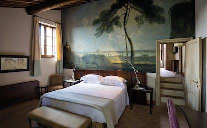 Castel Monastero Tuscany villa bedroom traditional décor nature mural