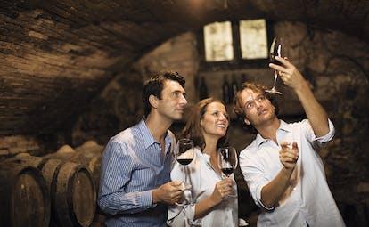 Castel Monastero Tuscany wine tasting wine cellar couple and wine expert