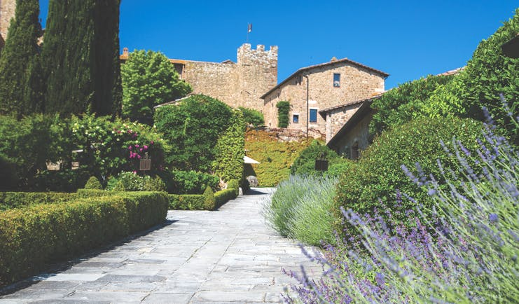 Castello Banfi Tuscany exterior path way lined with shrubs and flowers