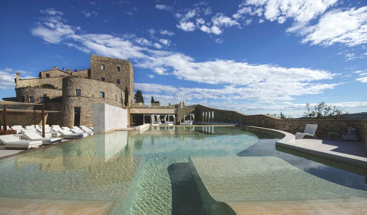 Castello di Velona Tuscany exterior pool in foreground hotel in background