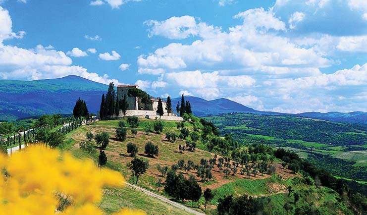 Castello di Velona Tuscany exterior shot of hotel on hillside overlooking Tuscan countryside