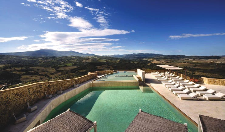 Castello di Velona Tuscany pool view sun loungers pool terrace views of countryside